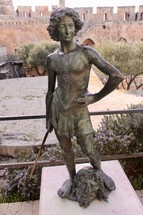 Bronze Statue of David standing over Goliath's Severed Head