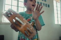 a child playing tambourines