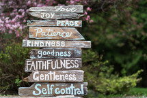 The fruit of the Spirit written on a sign made of rustic wooden planks.