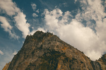 A rocky mountaintop among the clouds