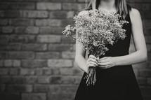 woman holding babies breath flowers