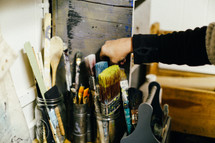 painting supplies and paint brushes in a tool box