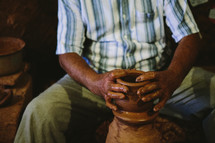 A man making pottery