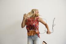a teenage girl dancing to music