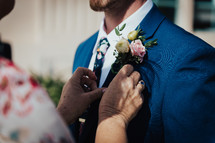 groom with a boutonniere