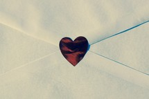 red heart sticker on a white envelope