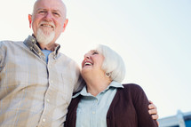 an elderly couple standing together