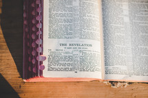 Bible opened to Revelations