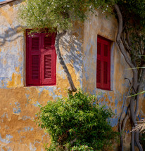 red shutters on a windows