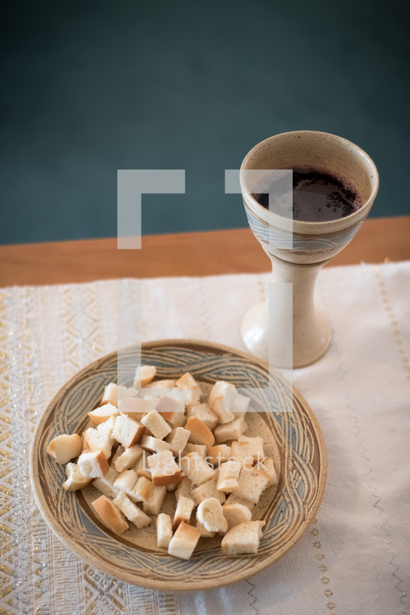 a chalice of wine and bowl of bread for communion