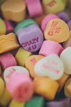 pile of candy conversation hearts for Valentine's Day