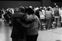 hugs of prayer at a worship service
