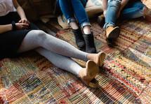 women's legs on a rug