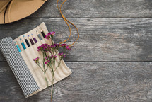 twine, colored pencils, bag, art suppiles, wildflowers