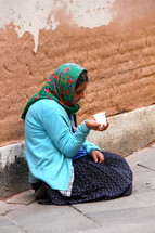 Homeless woman begging on the street