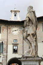 Soldier statue and clock tower and bell. Classical Italian art.