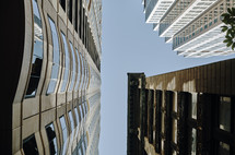 looking up to the top of tall city buildings
