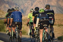 group of bike riders riding the scenic loop of Red Rock Canyon