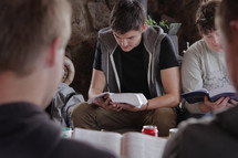 young men at a Bible study reading Bibles