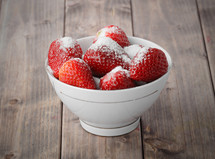 sugar on strawberries in a bowl
