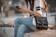 a teen girl looking at a cellphone screen