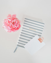 journal, notepad, and pink peony