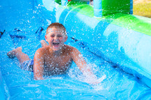 child on a waterslide