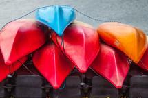 Stack of kayaks.