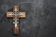 a decorative wooden cross with metallic details