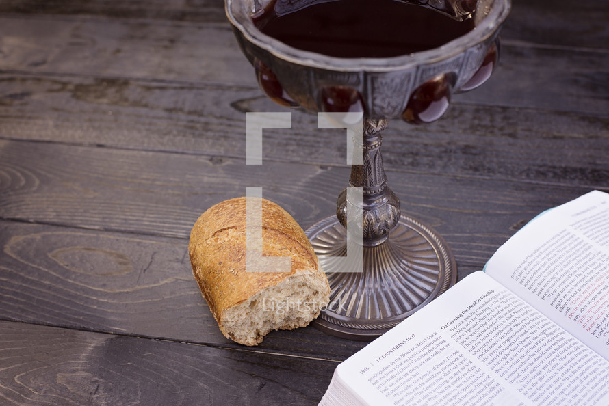 communion wine and bread and open Bible