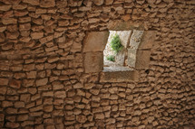 window opening in ruins at an historic site in Jordan