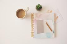 coffee mug, notebook, pencil, stationary
