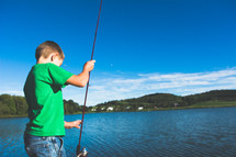 a boy child with a fishing pole