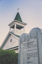 the ten commandments on a plaque in front of a church