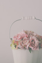 roses in a white pail