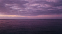 purple clouds over the ocean