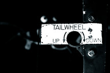 tailwheel up and down sign