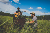 musicians playing tall grass