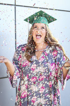 a graduate celebrating with confetti
