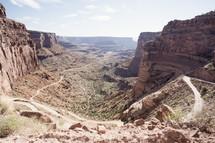 winding road through desert mountain cliffs