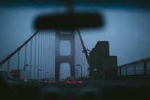 traffic on a foggy bridge