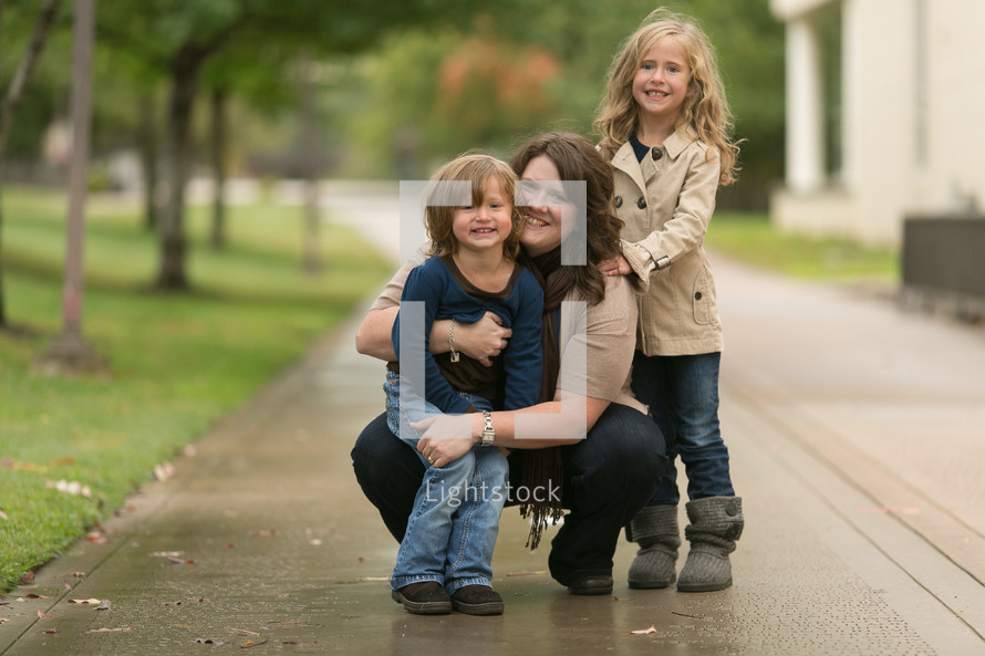 Mother and daughters smiling