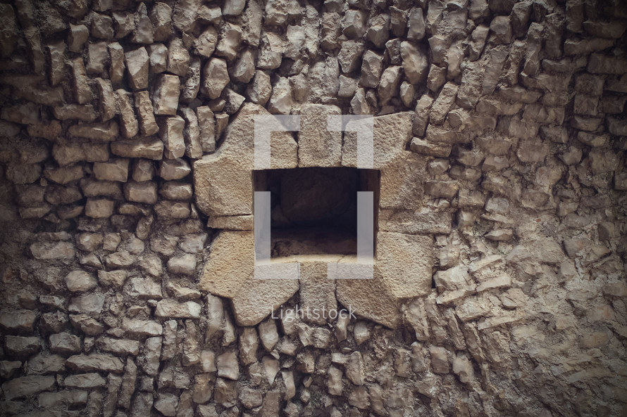 small opening in a stone wall