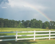 rainbow over farmland