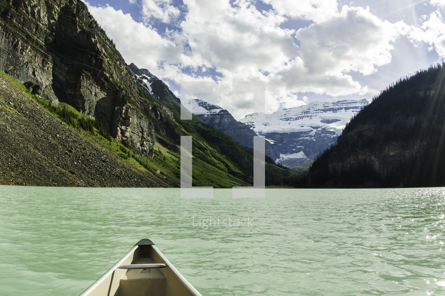 stern of a canoe on a mountain lake
