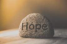 word hope on a stone
