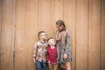 siblings standing in front of a barn