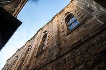 windows on a stone building in Jerusalem