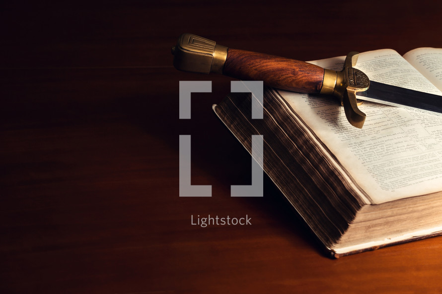 sword on the pages of a Bible