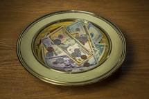Money in an offering collection plate